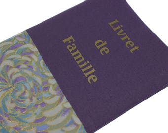 family booklet protector in purple and green floral fabric
