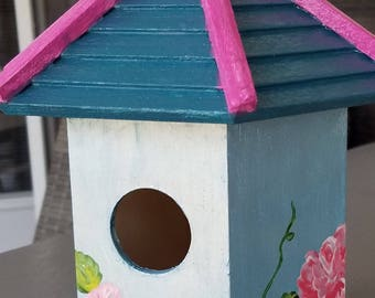 Beautiful, hand painted bird house.  Delicate, shimmering light blue with delicate pink roses.