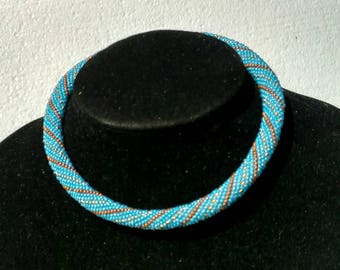 Necklace out of beads with geometric pattern. Beaded necklace. Crochet necklace