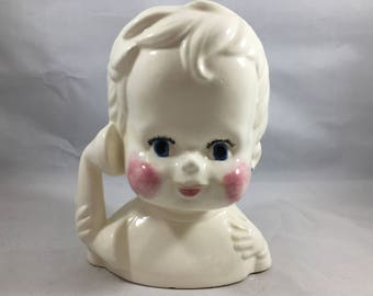 Weird and Slightly Eerie Vintage White and Pink Baby With Rosy Cheeks on the Phone Planter