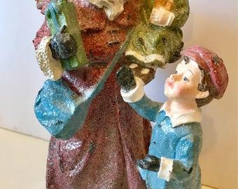 Glittery 9 1/2 inch Santa Claus with children figurine