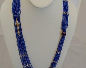 12 Strand Sapphire Blue Beaded Cross Necklace