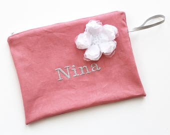 Personalized, embroidered linen pouch.