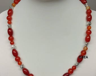 Carnelian necklace and beaded flowers.