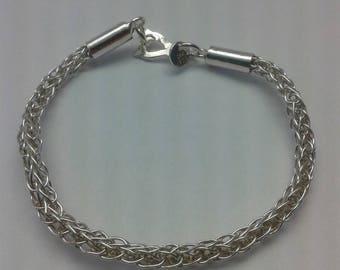 Hand woven sterling silver bracelet.