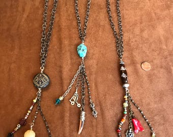 Long Necklace with tassel of amulets, old coins and African Trade Beads