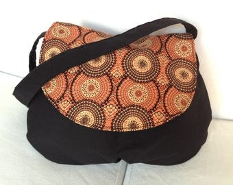 Small shoulder bag in black and orange fabric