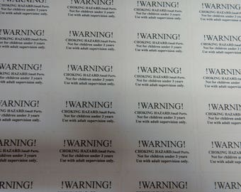 poly bag/packages   Suffocation Warning labels  printed on white stickers   64x38mm