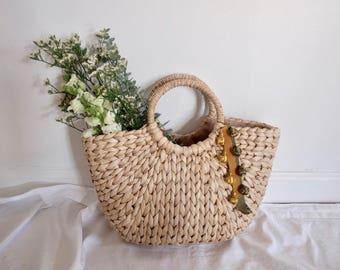 D'strawbag circle handle straw basket bag