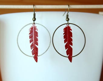 Earrings with bronze coloured ring and red metal pen