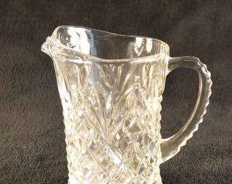 Vintage small clear glass water pitcher,creamer,scalloped handle,