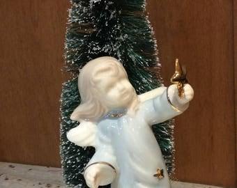Porcelain angel-blue-gold-stars-green bottle brush tree-glitter-tulle-porcelain bell-Christmas-holiday-winter-seasonal