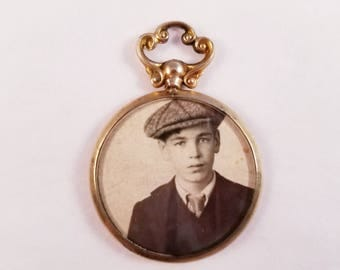 Antique double sided locket in yellow gold