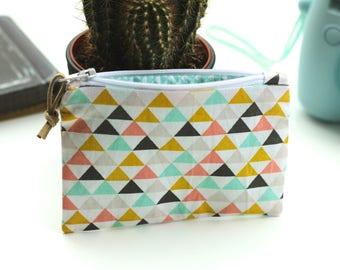 Petite pochette en coton aux motifs géométriques pastel avec fermeture zippée