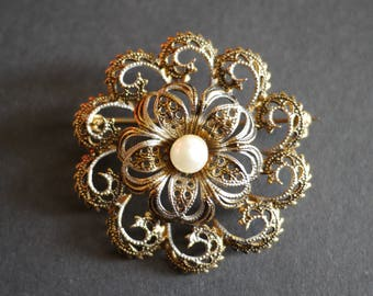 Damascene Toledo black and gold filigree flower brooch with faux pearl centre