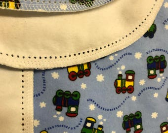Serged edge hemstitched flannel baby blanket.