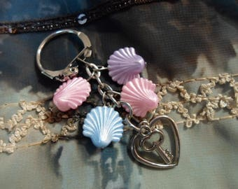 Key and shell charms and silver