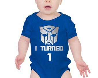 """Transformers inspired baby's 1st birthday bodysuit baby grow onesie with silver text """"I Turned 1""""."""
