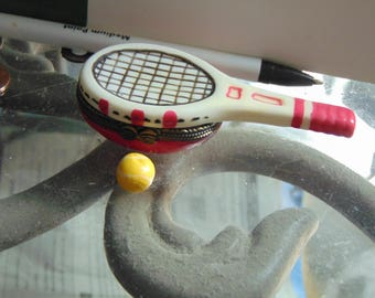 Tennis raquet and tennis ball