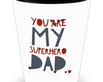 You are my Superhero DAD #1 DAD!!! Let him know how much you care with every shot! White Ceramic Shot Glass Gift!