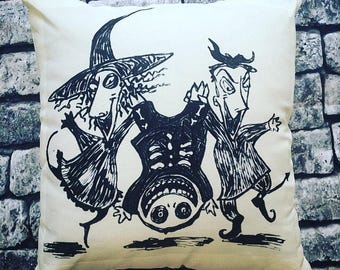 The nightmare before christmas hand illustrated cream cushion. Lock, Shock and Barrel illustration in three styles. 46cm x46cm with insert.