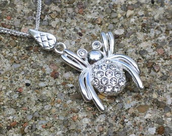 Sterling silver necklace and pendant decorated with zirconium spider.