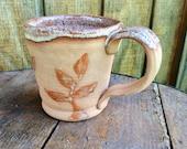 Pottery Mug with Vine Design
