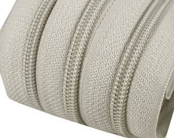 6m of endless zipper 5mm with 15 zippers and tails 310 light grey