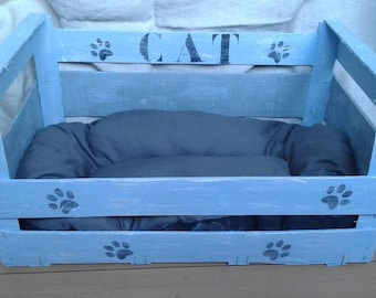 crate into a weathered cat basket