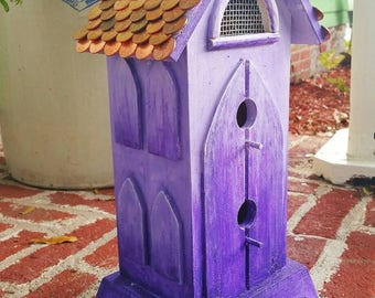 "This rustic Birdhouse boasts a ""Copper Penny"" roof paired with a bold purple ombre color it's sure to be a focal point in any home decor!"