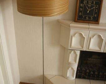 Wood veneer floor lamp with stainless steel lamp stand.