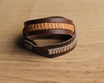 Leather stitched three tone bracelet with bronze magnetic clasp.