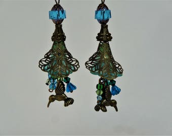 Hummingbird dangle earrings with blue and green flowers, Czech glass beads and brass findings. lucite lily