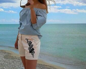 Summer blouse on shoulders