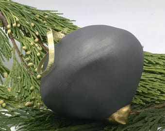 Matte black ornament with gold luster detail