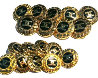 Chanel Black and gold buttons in groups of 9 buttons. Two measures.