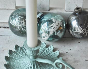 Green painted metal candle holder with feather detail