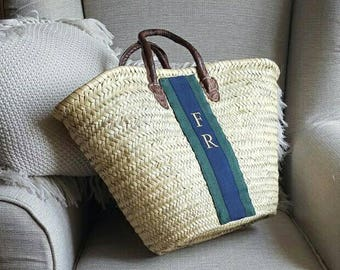 Straw bag with leather handles and embroidered monogram