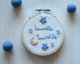hand embroidered frame with buttons in the shape of stars and moon