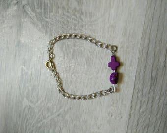 Head and purple cross bracelet