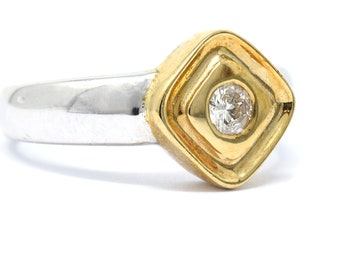 two tone diamond ring in heavy 9ct gold with 1/4 Carat G SI grade diamond