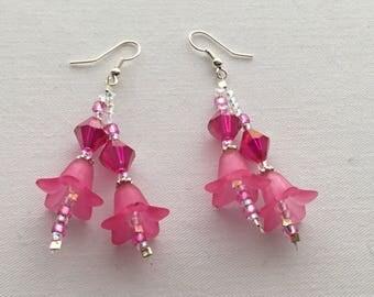 Bright pink dangly flower earrings