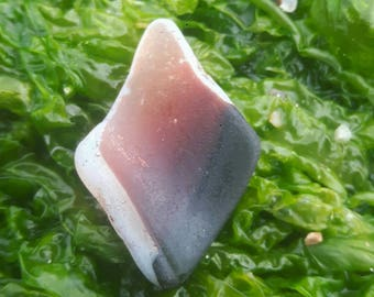 red patterned sea glass piece with uv backing genuine surf tumbled beach find scottish sea glass uv sea glass