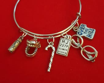Over The Hill Themed Charm Bracelet