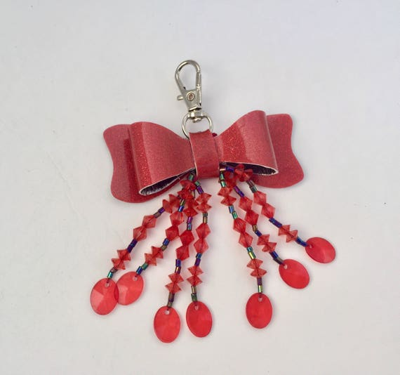 Sparkly and shiny beaded red bow planner charm on swivel clasp!  This charm will add character to your planner, notebook, or journal.