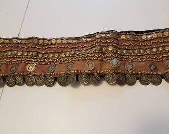 Bronze decorative hip belt with beading and coins.