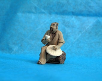 Chinese mudman figurine for your bonsai tree or ornamental plant.