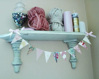 Decorative flag bunting or banner for shelves, walls, and other areas of your home.