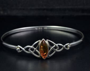 Celtic Design Sterling Silver Bracelet with Trinity Knots and an Amber Stone