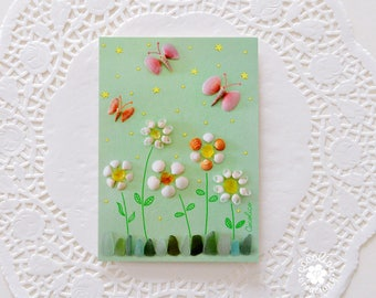 Map postcard composition flowers and butterflies with shells